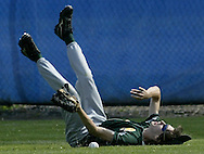 John A. Coleman's Mike Sirbaugh falls after trying to make a catch in right field against Chapel Field in the Section 9 Class D championship game at SUNY New Paltz on Friday, May 28, 2010.