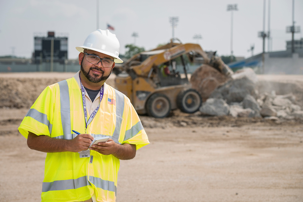 Magdaleno Orozco poses for a photograph at the Delmar-Tusa Fieldhouse construction site, July 24, 2014.