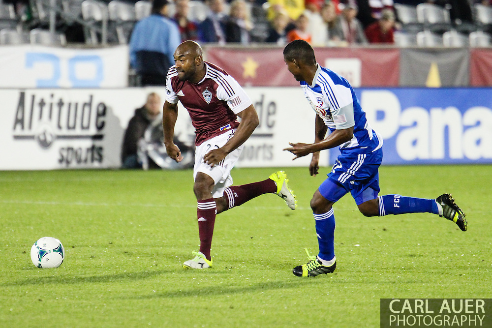 September 14th, 2013 -  Colorado Rapids defender Marvell Wynne (22) brings the ball up the field past FC Dallas midfielder Erick (12) in first half action of the MLS Soccer game between FC Dallas and the Colorado Rapids at Dick's Sporting Goods Park in Commerce City, CO