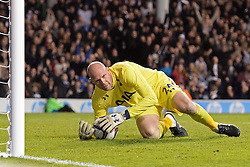 Tottenham's Brad Friedel reacts after saving a penalty - Photo mandatory by-line: Mitchell Gunn/JMP - Tel: Mobile: 07966 386802 30/10/2013 - SPORT - FOOTBALL - White Hart Lane - London - Tottenham Hotspur v Hull City - Capital One Cup - Forth Round
