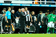 Newcastle United manager Steve Bruce issues instructions to Andy Carroll (#7) of Newcastle United as he waits to be substituted onto the pitch during the Premier League match between Newcastle United and Brighton and Hove Albion at St. James's Park, Newcastle, England on 21 September 2019.