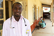 Doctor Ivan Nyenje outside Kasangati Health Centre in Uganda.