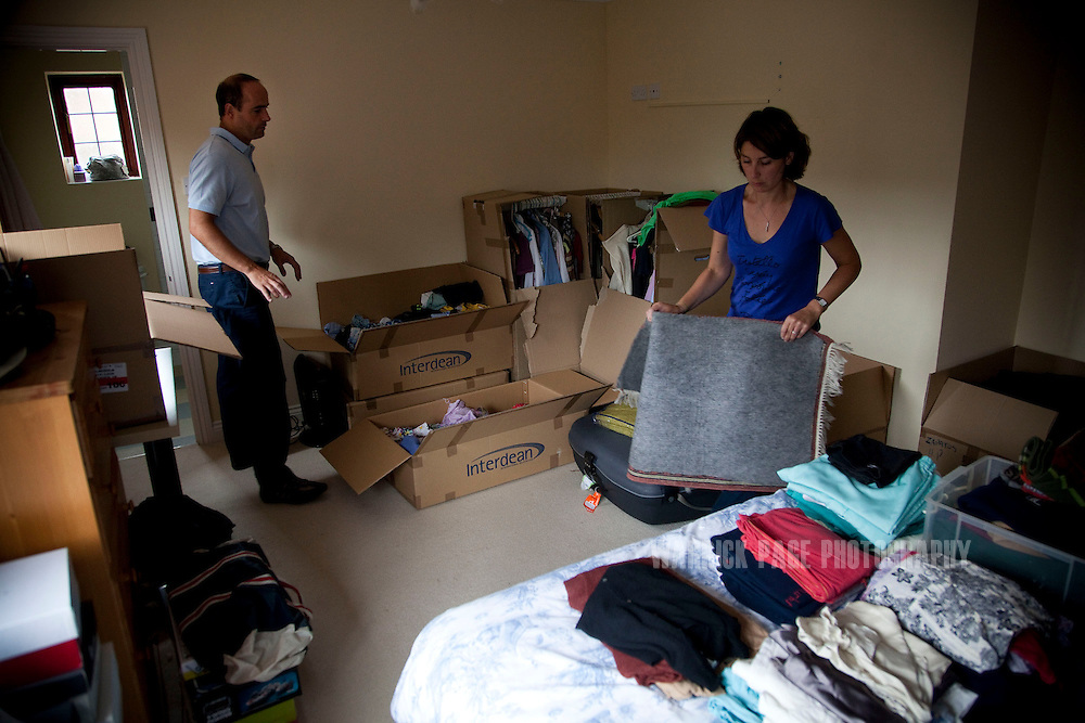 Julio and Eva Vildosola unpack the remainder of their belongings in their new home, on September 1, 2012, in Buckden, England. The Spanish family immigrated to England due to the ongoing economic crisis that has impacted heavily on Spain. (Photo by Warrick Page)