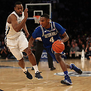 Sterling Gibbs, (right), Seton Hall, drives past James Bell, Villanova,  during the Villanova Wildcats Vs Seton Hall Pirates basketball game during the Big East Conference Tournament at Madison Square Garden, New York, USA. 12th March 2014. Photo Tim Clayton
