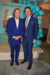 Left to right, Tom Parker Bowles and Ewan Venters at the launch of the Fortnum & Mason Christmas & Other Winter Feasts Cook Book by Tom Parker Bowles held at Fortnum & Mason, 181 Piccadilly, London, England. 17 October 2018.