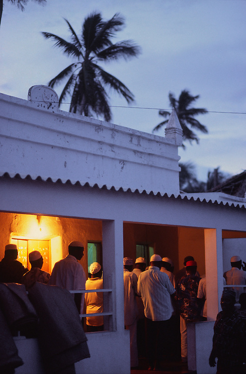 Men praying in a mosque in the Macuti City, the part of Ilha de Mozambique where lives most of the inhabitants