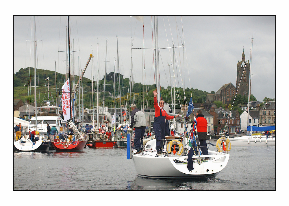 Racing was cancelled due to lack of wind on the last day of the Bell Lawrie Yachting Series in Tarbert Loch Fyne...Class 2 winners, Antix, a Corby 35 owned by Anthony O'Leary ( waving ),   won their class and the event overall after the last day's racing was cancelled due to a lack of breeze...