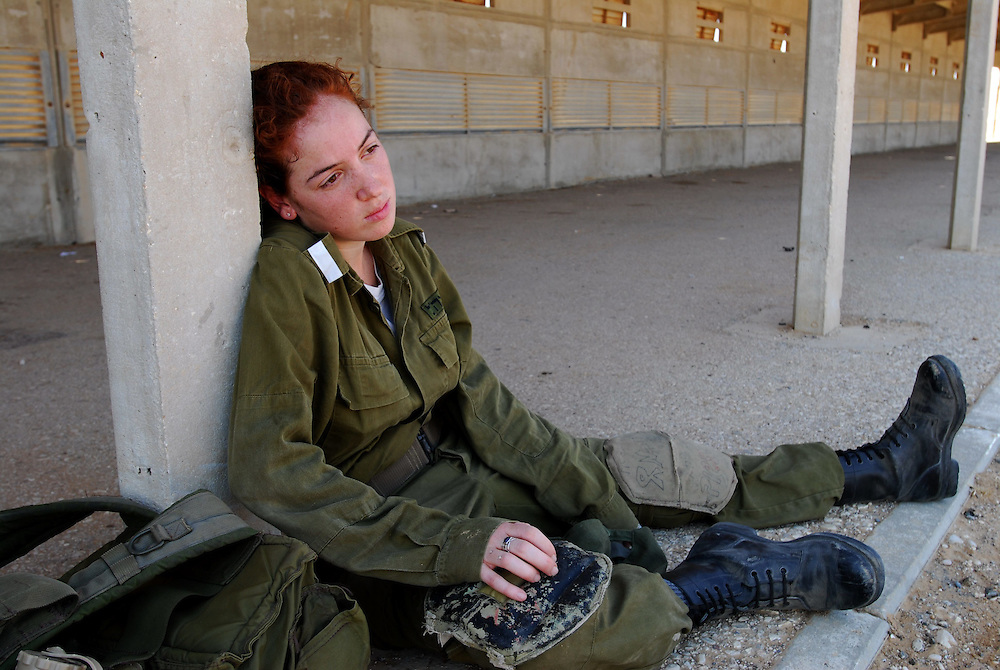 An IDF woman reserve soldier during training in the Negev Desert, South Israel on September 15, 2008. Following their active service, women, like men, are in theory required to serve up to one month annually in reserve duty. However, in practice only some women, mostly in combat roles, get called for active reserve duty, and only for a few years following their active service, with many exit points (e.g., pregnancy).