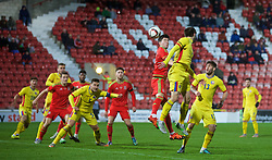 WREXHAM, WALES - Tuesday, November 17, 2015: Wales' Callum Saunders in action against Romania during the UEFA Under-21 Championship Qualifying Group 5 match at the Racecourse Ground. (Pic by David Rawcliffe/Propaganda)