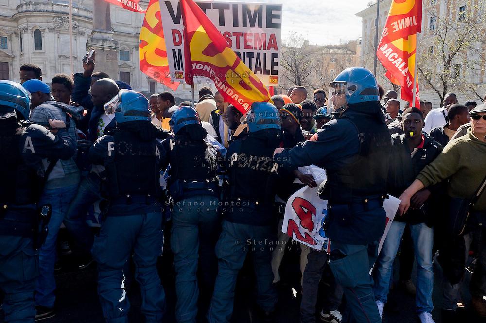 Roma, 23 Marzo 2015<br /> Manifestazione di migranti richiedenti asilo che chiedono un  permesso di soggiorno umanitario per tutti, un&rsquo;accoglienza dignitosa  e la possibilit&agrave; di un lavoro per tutti e per dire &laquo;no allo sfruttamento e al business dell&rsquo;accoglienza&raquo;. La manifestazione &egrave; organizzata dal sindacato  Usb.La polizia blocca i migranti che volevano andare in corteo verso la prefettura. <br /> Rome, March 23, 2015<br /> Demonstration by asylum-seeking immigrants who they ask  a humanitarian residence permit for all , decent reception and the possibility of a job for everyone and say &quot;no to exploitation and to the business of hospitality.&quot; The protest  is organized by the union Usb. Police block migrants who wanted to go in marching  to the prefecture.