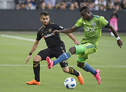 April 29, 2018 - Los Angeles, California, U.S - 29 April 2018, Los Angeles, Ca.,The Los Angeles Football Club (LAFC) beat the Seattle Sounders in the inaugural game at the new Banc of California Stadium. Pictured is Sounders' Nouhou defended by LAFC's Diego Rossi. (Credit Image: © Prensa Internacional via ZUMA Wire)