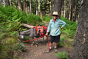 "Jasmine, a miniature donkey, hikes on Mount Lemmon with her ""agent"", Leigh Anne Thrasher, in the Santa Catalina Mountains north of Tucson, Arizona, USA.  The two hike regularly and can often be found on the Arizona Trail, which runs from Mexico to Utah."