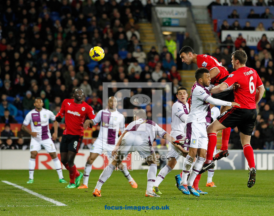 Steven Caulker of Cardiff City and Leandro Bacuna of Aston Villa during the Barclays Premier League match at the Cardiff City Stadium, Cardiff<br /> Picture by Mike  Griffiths/Focus Images Ltd +44 7766 223933<br /> 11/02/2014