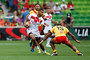 Kallum Watkins of England about to get tackled by Stargroth Amean of Papua New Guinea  during the Rugby League World Cup Quarter-Final match between England and  Papua New Guinea at Melbourne Rectangular Stadium, Melbourne, Australia on 19 November 2017. Photo by Mark  Witte.