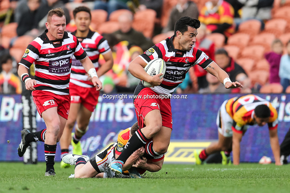 Counties Maunkau's Sherwin Stowers looks to break a tackle during the ITM Cup rugby match - Waikato v Counties Manukau at Waikato Stadium, Hamilton on Sunday 14 September 2014.  Photo: Bruce Lim / www.photosport.co.nz