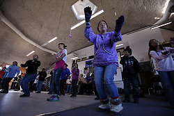 USA ALASKA POINT HOPE 22JUL12 - Inupiat residents of Point Hope sing and dance during a community meeting and dance at Point Hope, North Slope Borough, Alaska...Music is important for the Inupiat people living in the Arctic: most families have their own songs and dances that have been handed down from their ancestors ..Point Hope is one of the oldest continually occupied sites in North America.......Photo by Jiri Rezac / Greenpeace..© Jiri Rezac / Greenpeace