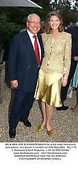 MR & MRS URS SCHWARZENBACH he is the multi millionaire polo patron, at a dinner in London on 24th May 2004.PUJ 176