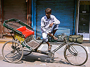 rickshaw puller in paharganj, delhi, india