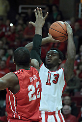 15 February 2014:  Daishon Knight works his way to the hoop against Xzavier Taylor during an NCAA Missouri Valley Conference (MVC) mens basketball game between the Bradley Braves and the Illinois State Redbirds  in Redbird Arena, Normal IL.