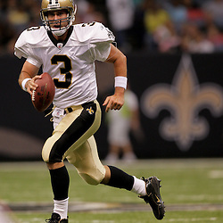 2009 September 03: New Orleans Saints quarterback Joey Harrington (3) scrambles from the pocket during a preseason game between the Miami Dolphins and the New Orleans Saints at the Louisiana Superdome in New Orleans, Louisiana.
