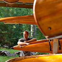 LIVE OAK, FL -- September 30, 2010 -- Boatwright Aaron Wells of Cypress Kayaks LLC, near his past hand-made kayaks at his workshop in Live Oak, Fla., on Thursday, September 30, 2010.  (Chip Litherland for Bay Magazine)