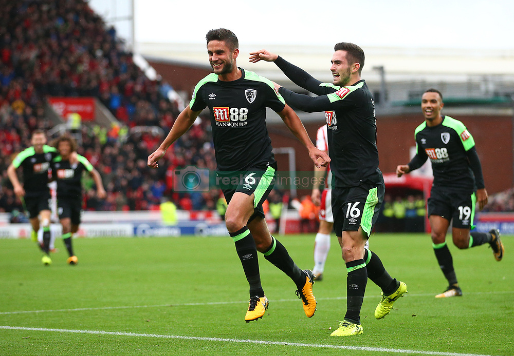 AFC Bournemouth's Andrew Surman (left) celebrates scoring his side's first goal with team-mate Lewis Cook during the Premier League match at the bet365 Stadium, Stoke-on-Trent.