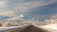 Hoarfrost covers the boreal forest along the Glenn Highway with Gunsight Mountain in Southcentral Alaska. Winter. Morning.