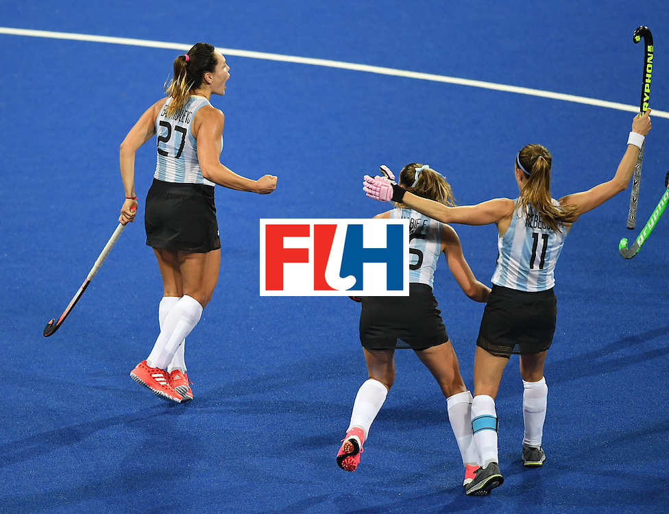 Argentina's Maria Noel Barrionuevo (L) celebrates scoring a goal with teammates during the women's field hockey Argentina vs Japan match of the Rio 2016 Olympics Games at the Olympic Hockey Centre in Rio de Janeiro on August, 8 2016. / AFP / MANAN VATSYAYANA        (Photo credit should read MANAN VATSYAYANA/AFP/Getty Images)