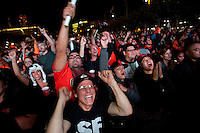SAN FRANCISCO, CA - NOV 1:  San Francisco Giants fans react after watching the Giants defeat the Texas Rangers to win the World Series in 5 games at the Civic Center Plaza on November 1, 2010 in San Francisco, California.  The Giants won their first World Series in 56 years since moving to San Francisco from New York.  Photograph by David Paul Morris
