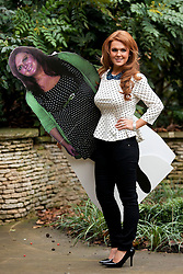 © Licensed to London News Pictures. 25/01/2013. London, UK. Liz Evans (27), Slimming World's Miss Slinky 2013, is seen with a cardboard cut-out of her former self in the garden of the Ritz Hotel in London today (25/01/13). Liz, formerly a size 18, lost 5 stone in less than eight months to become a size 8 in preparation for her wedding day. Photo credit: Matt Cetti-Roberts/LNP