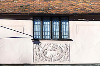 A panel of floral pargetting on a 16th century house in Lavenham, Suffolk, UK