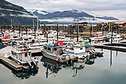 Fishing boats docked the Whittier marina on the Passage Canal in Prince William Sound, Whittier, Alaska.