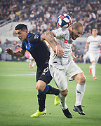 LAFC defender Jordan Harvey (2) battles San Jose Earthquakes forward Cristian Espinoza (10) for ball during an MLS soccer match. LAFC defeated the San Jose Earthquakes 4 - 0 on Wednesday, Aug. 21, 2019, in Los Angeles. (Ed Ruvalcaba/Image of Sport)