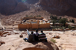 Three men look at the Saint Catherine's Monastery at the foot of Mount Sinai in Saint Catherine, South Sinai Province, Egypt, Dec 27, 2014. The site is popular among visitors from around the world who come to see the Saint Catherine's Monastery, a UNESCO World Heritage Site said to be where Moses received the stone tablets bearing the Ten Commandments. EXPA Pictures © 2014, PhotoCredit: EXPA/ Photoshot/ Ahmed Gomaa<br /> <br /> *****ATTENTION - for AUT, SLO, CRO, SRB, BIH, MAZ only*****