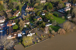 © Licensed to London News Pictures. 21/12/2019. Pulborough, UK. Flood water fills the gardens of houses in Pulborough, West Sussex after the River Arun burst its banks and flooded local businesses and farm land. River levels remain high after heavy overnight rain in the south where more rain is expected today. Photo credit: Peter Macdiarmid/LNP