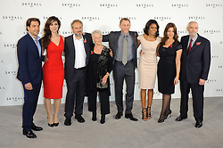 Javier Bardem, Berenice Marlohe, director Sam Mendes, Dame Judi Dench, Daniel Craig, Naomie Harris, producer Barbara Broccoli and producer Michael G. Wilson pose for photographers at the photocall for the 23rd James Bond movie 'Skyfall', London, Thursday November 3, 2011. Photo By i-Images