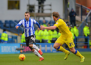 Sheffield Wednesday Defender Jack Hunt runs at Leeds United Defender Charlie Taylor during the Sky Bet Championship match between Sheffield Wednesday and Leeds United at Hillsborough, Sheffield, England on 16 January 2016. Photo by Adam Rivers.