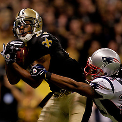 2009 November 30:  New Orleans Saints wide receiver Robert Meachem (17) scores a touchdown past New England Patriots cornerback Jonathan Wilhite (24) during the first half at the Louisiana Superdome in New Orleans, Louisiana.