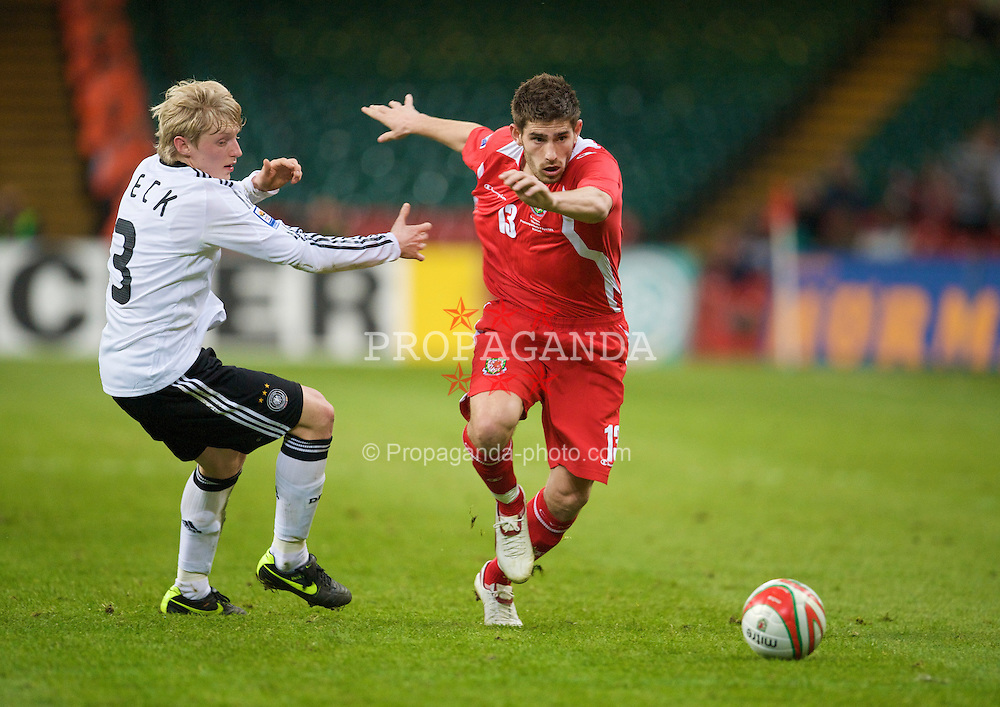 CARDIFF, WALES - Wednesday, April 1, 2009: Wales' Ched Evans and Germany's Andreas Beck during the 2010 FIFA World Cup Qualifying Group 4 match at the Millennium Stadium. (Pic by David Rawcliffe/Propaganda)