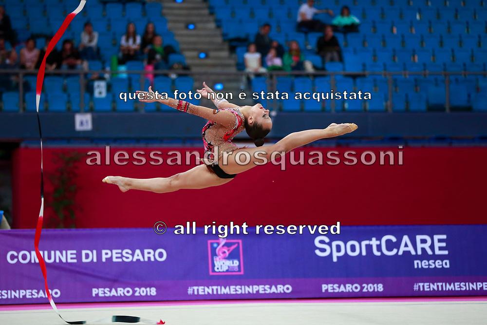 Agagulian Iasmina during qualifying at ribbon in Pesaro World Cup at Adriatic Arena on April 14, 2018. Iasmina is an Armenian rhythmic gymnastics athlete born in Yerevan in 2001.