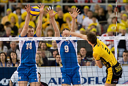 Dmitry Shcherbinin and Yury Berezhko of Dinamo vs Mariusz Wlazly of Belchatow at 1st Semifinal match of CEV Indesit Champions League FINAL FOUR tournament between PGE Skra Belchatow, Poland and Dinamo Moscow, Russia, on May 1, 2010, at Arena Atlas, Lodz, Poland. (Photo by Vid Ponikvar / Sportida)