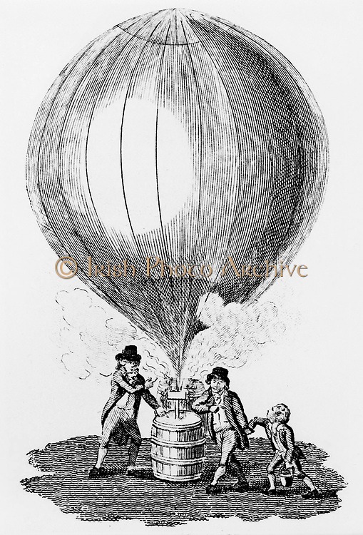 Robert brothers helping JAC Charles (1746-1823) to inflate balloon with hydrogen produced by covering barrel of iron filings with sulphuric acid. On 1 December 1783 Charles and one of brothers made first ascent in hydrogen balloon. Engraving c1807.