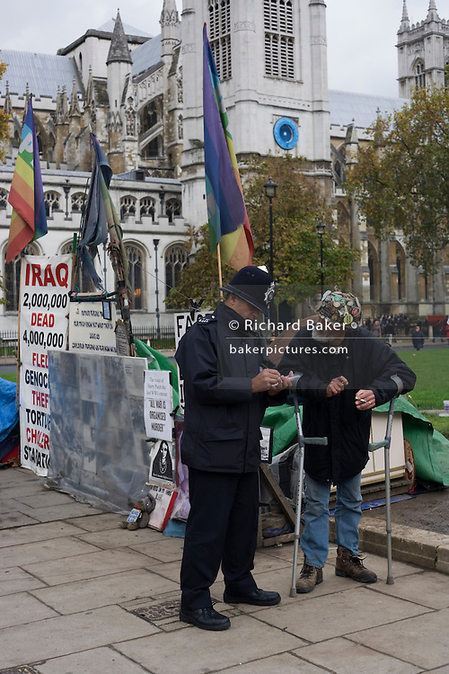 Anti-War protester Brian Haw questioned by police at his peace camp in Parliament Square on Remembrance Sunday.<br /> <br /> http://www.parliament-square.org.uk/