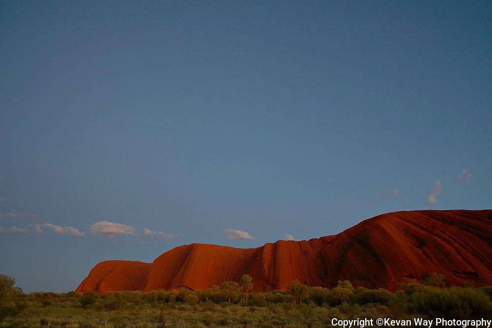 dawn light over Uluru
