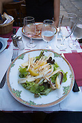 Le Tire-Bouchon, a traditional restaurant in the old town at the foot of the Citadel. Salade de seiche (sepia salad) and Lonzo (smoked pork ham).