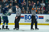 KELOWNA, BC - JANUARY 24: Referee Nick Panter makes a high sticking call on Tyrel Bauer #6 of the Seattle Thunderbirds as line official Brett Mackey escorts him ot the penalty box during first period against the Kelowna Rockets at Prospera Place on January 24, 2020 in Kelowna, Canada. (Photo by Marissa Baecker/Shoot the Breeze)