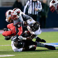 Thomas Wells | Buy at PHOTOS.DJOURNAL.COM<br /> Petal running back Stephon Huderson gets pulled down after a short gain in Friday's class 6A State Championship game in Oxford.