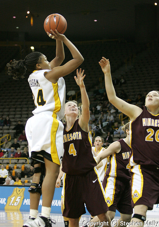 25 JANUARY 2007: Iowa forward Jenee Graham (24) takes a shot in front of Minnesota guard Emily Fox (4) in Iowa's 80-78 overtime loss to Minnesota at Carver-Hawkeye Arena in Iowa City, Iowa on January 25, 2007.