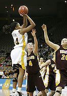 25 JANUARY 2007: Iowa forward Jenee Graham (24) takes a shot in front of Minnesota guard Emily Fox (4) in Iowa's 80-78 overtime loss to Minnesota at Carver-Hawkeye Arena in Iowa City, Iowa on January 25, 2007.