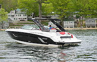 Jason St Gelais Sales Manager at Channel Marine takes out a Cruiser Sport Series 328 Black Diamond in Weirs Channel Friday morning.  (Karen Bobotas/for the Laconia Daily Sun)